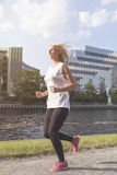Young woman jogging in city Stock Photo