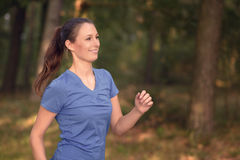 Young woman jogging in the countryside Stock Photography