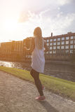 Young woman jogging in evening light Stock Photo