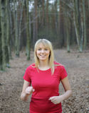 Young woman jogging in the forest Stock Photos
