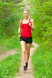 Young woman jogging in forest Royalty Free Stock Photo