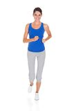 Young woman jogging. Happy Young Woman Jogging Over White Background Royalty Free Stock Photography