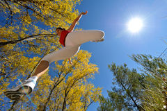 Young woman jogging/jumping outdoor royalty free stock photo