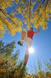 Young woman jogging/jumping outdoor Royalty Free Stock Image