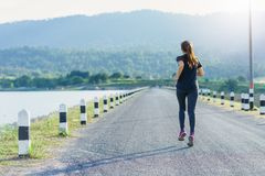 Young woman jogging in nature stock photography