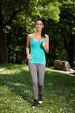 Young woman jogging in nature smiling Royalty Free Stock Photo
