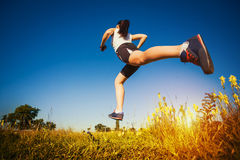 Young woman jogging in nature Royalty Free Stock Images