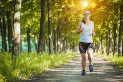Young woman jogging in nature Stock Image