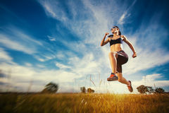Young woman jogging in nature Royalty Free Stock Photo