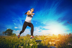 Young woman jogging in nature Royalty Free Stock Photography