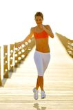 Young woman jogging outdoor Stock Photos