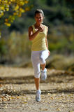 Young woman jogging outdoor Stock Photography
