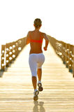 Young woman jogging outdoor Royalty Free Stock Photography