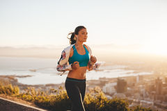 Young woman jogging outdoor Royalty Free Stock Photos