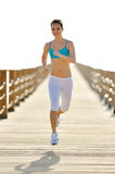 Young woman jogging outdoor in summer Royalty Free Stock Photos