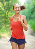 Young woman jogging outdoors Stock Image