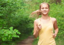 Young woman jogging outdoors Royalty Free Stock Image