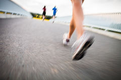 Young woman jogging outdoors Royalty Free Stock Images