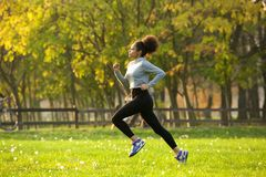 Young woman jogging outdoors stock photo