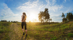 Young woman jogging outdoors Stock Photography