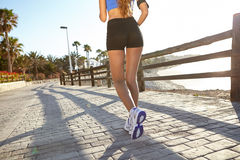 Young woman jogging outside in summertime Royalty Free Stock Image