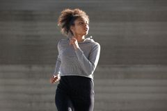 Young woman jogging outside in urban environment Stock Image