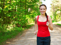 Young woman jogging in park Stock Photo
