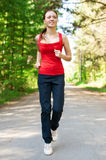 Young woman jogging in park Royalty Free Stock Photos