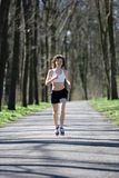 Young woman during jogging in a park Stock Image
