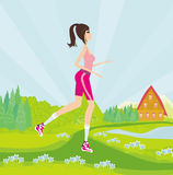 Young woman jogging at park Stock Image