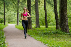 Young woman jogging in the park Stock Photo