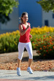 Young woman jogging in the park Royalty Free Stock Photography