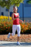 Young woman jogging in the park Royalty Free Stock Photo