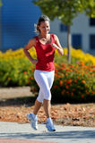 Young woman jogging in the park in summer Stock Photos