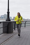 Young woman jogging by the River Royalty Free Stock Images