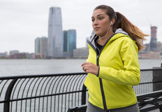 Young woman jogging by the River Stock Photo