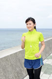 Young woman jogging by the sea Royalty Free Stock Photo