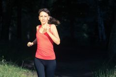 Young woman jogging in summer park. Stock Image