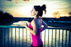 Young woman jogging at sunset Stock Image