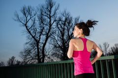 Young woman jogging at sunset Royalty Free Stock Images