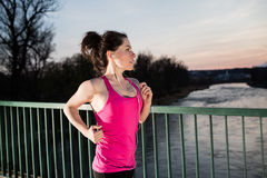 Young woman jogging at sunset royalty free stock photography