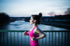 Young woman jogging at sunset Stock Images