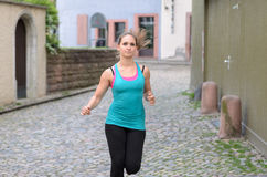 Young woman jogging in town Royalty Free Stock Image