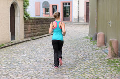 Young woman jogging in town Stock Image