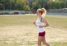 Young woman jogging, training outdoors Stock Photo