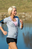 Young woman jogging water park in summer Stock Photo