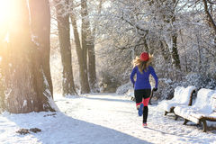 Young woman jogging in winter Stock Photos