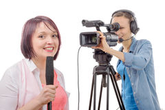 Young woman journalist with a microphone and camerawoman Royalty Free Stock Photography
