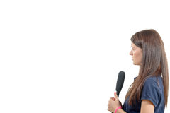 A young woman journalist with a microphone. Isolated on white background Stock Photo