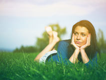 Young woman joy and relaxing on grass Stock Images